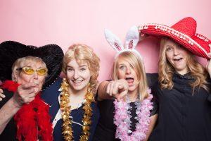 girls having fun in photo booth