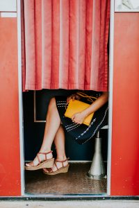 Detail of a woman sitting in photo booth