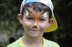 Child at school carnival with face paint