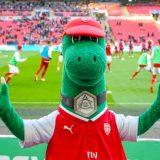 green dinosaur school mascot