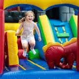 happy child jumping in bounce house